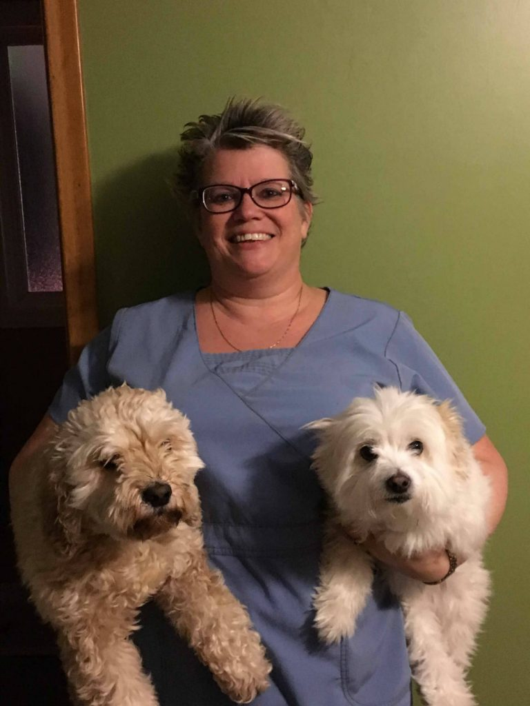 Lisa Clifford holding two dogs