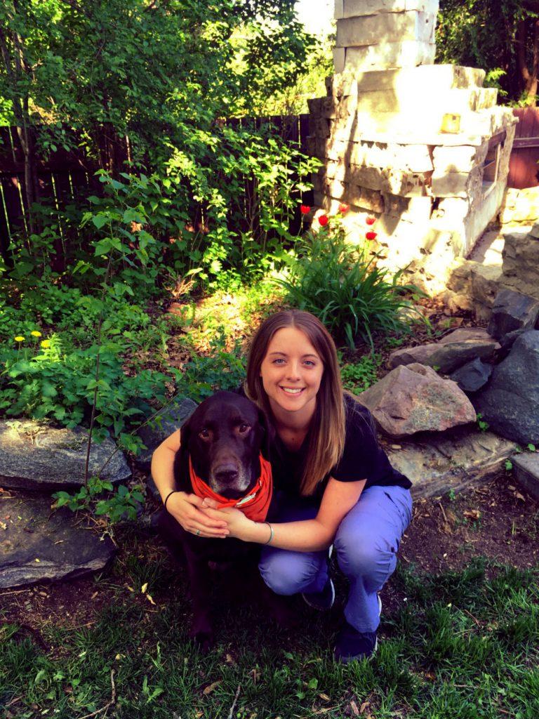 Brittany Gaw with a dog