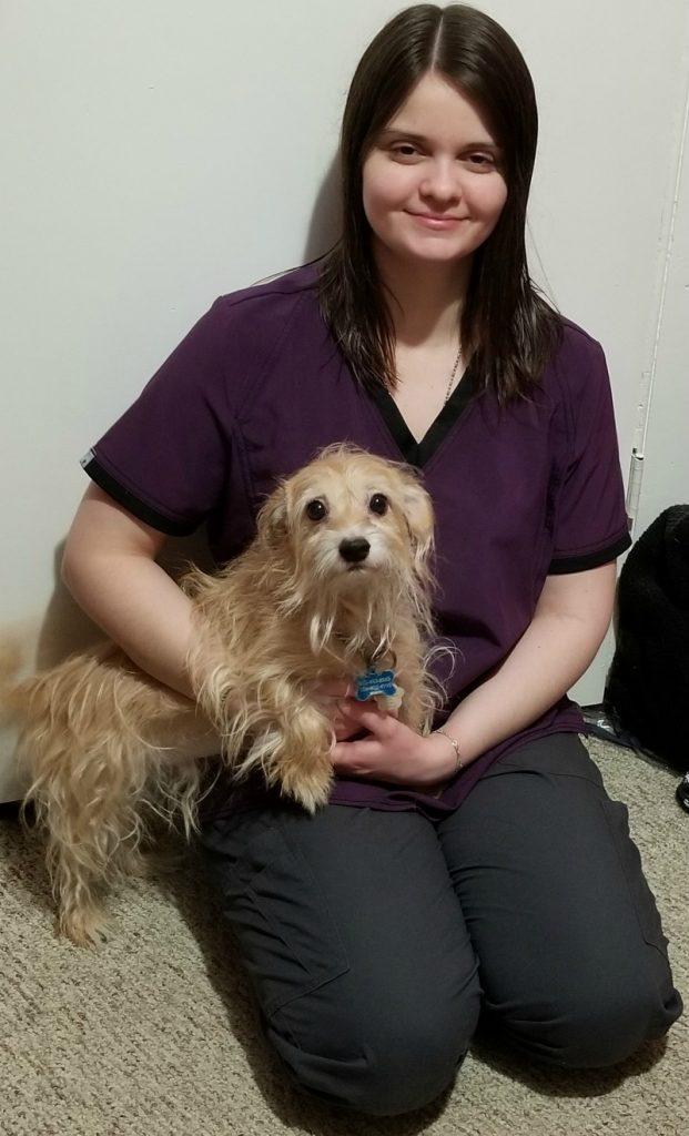 Alisa Weaver holding a dog