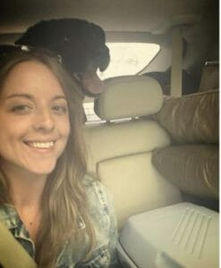 Abe the dog and Britt in a car
